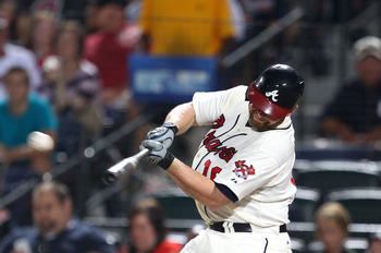 ATLANTA, GA - SEPTEMBER 29:  Catcher Brian McCann #16 of the Atlanta Braves hits a single during the game against the Atlanta Braves New York Mets at Turner Field on September 29, 2012 in Atlanta, Georgia.  (Photo by Mike Zarrilli/Getty Images)