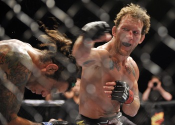 Jun 22, 2012; Atlantic City, NJ, USA; Clay Guida (left) fights Gray Maynard in a lightweight bout during UFC on FX at Revel Resort and Casino. Gray Maynard won the fight by split decision in the fifth round.  Mandatory Credit: Joe Camporeale-USA TODAY Spo