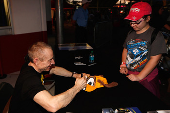 Mark Martin signs an autograph for a fan Friday at NASCAR Preseason Thunder in Daytona, Fla.
