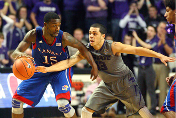 Jan 22, 2013; Manhattan, KS, USA; Kansas State Wildcats guard Angel Rodriguez (13) tries to steal the ball from Kansas Jayhawks guard Elijah Johnson (15) during the Wildcats' 59-55 loss at Bramlage Coliseum. Mandatory Credit: Scott Sewell-USA TODAY Sports