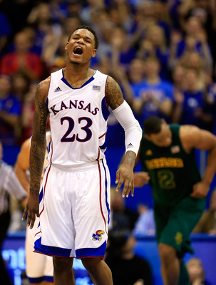 LAWRENCE, KS - JANUARY 14:  Ben McLemore #23 of the Kansas Jayhawks reacts after making a three-pointer during the game against the Baylor Bears at Allen Fieldhouse on January 14, 2013 in Lawrence, Kansas.  (Photo by Jamie Squire/Getty Images)