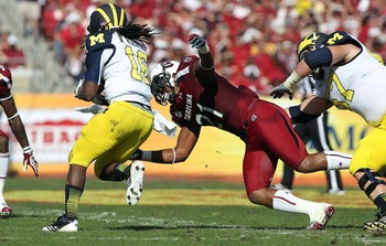 Holloman making a play on Michigan's Denard Robinson.