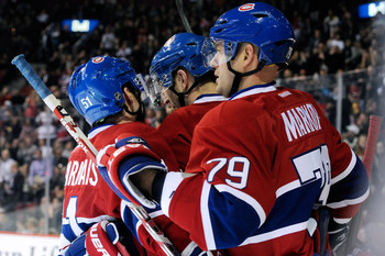 Andrei Markov (right) and teammates celebrate.