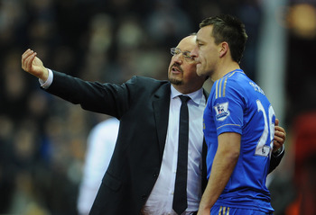 John Terry pretends to listen to Benitez, before issuing his own instructions to the team.