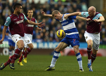 READING, ENGLAND - DECEMBER 29:  Pavel Pogrebnyak of Reading battles with James Collins of West Ham United during the Barclays Premier League match between Reading and West Ham United at the Madejski Stadium on December 29, 2012 in Reading, England.  (Pho