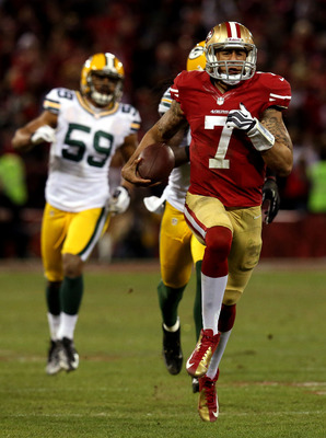 Colin Kaepernick runs for a score.
