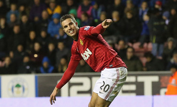 Robin van Persie's 21st goal of the season put Manchester United en route to a 2-1 win at home to Liverpool.