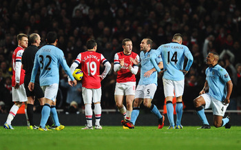 Vincent Kompany (far right) was sent off at Arsenal, although Manchester City manager Roberto Mancini says the red card will be appealed.
