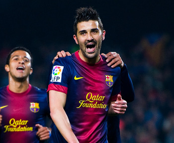BARCELONA, SPAIN - JANUARY 10:  David Villa of FC Barcelona celebrates with his team-mates after scoring their second goal during the Copa del Rey round of sixteen second leg match between FC Barcelona and Cordoba CF at Camp Nou on January 10, 2013 in Bar