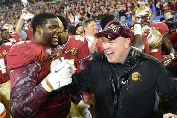 DT Demonte McAllister celebrates with former DC Mark Stoops as FSU wins the ACC Championship.