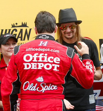 One badass saying hello to another badass (Tony Stewart and Kid Rock).