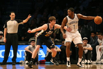 Dec 18, 2012; New York, NY, USA;  Utah Jazz shooting guard Gordon Hayward (20) holds Brooklyn Nets shooting guard Joe Johnson (7) from his drive during the fourth quarter at Barclays Center.  Utah won 92-90.  Mandatory Credit: Anthony Gruppuso-USA TODAY S
