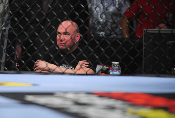 Dana White sitting cageside at Strikeforce events remains an odd sight.