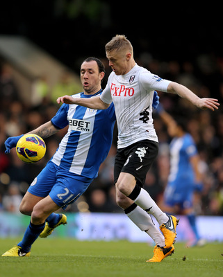 Wigan defender Ivan Ramis suffered a serious injury at Fulham on Saturday.