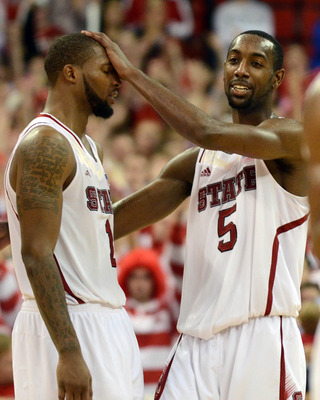Jan 12, 2013; Raleigh, NC, USA; North Carolina State Wolfpack forward C.J. Leslie (5) and forward Richard Howell (1) celebrate toward the end of an upset over the Duke Blue Devils at PNC Arena. North Carolina State won 84-76.   Mandatory Credit: Rob Kinna