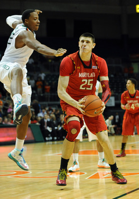 Jan 13, 2013; Coral Gables, FL, USA; Maryland Terrapins center Alex Len (25) is defended by Miami Hurricanes forward/center Kenny Kadji (35) during the first half at the BankUnited Center. Mandatory Credit: Steve Mitchell-USA TODAY Sports