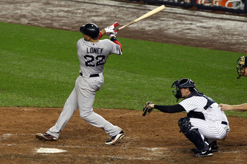 Oct. 2, 2012; Bronx, NY, USA; Boston Red Sox first baseman James Loney hits a solo home run during the ninth inning against the New York Yankees at Yankee Stadium. Yankees win 4-3 in 12 innings. Mandatory Credit: Debby Wong-USA TODAY Sports
