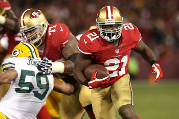 SAN FRANCISCO, CA - JANUARY 12:  Running back Frank Gore #21 of the San Francisco 49ers runs the ball against the Green Bay Packers during the NFC Divisional Playoff Game at Candlestick Park on January 12, 2013 in San Francisco, California.  (Photo by Ste