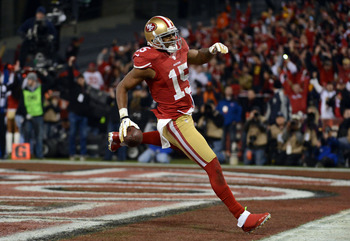 SAN FRANCISCO, CA - JANUARY 12:  Wide receiver Michael Crabtree #15 of the San Francisco 49ers runs the ball in for a touchdown thrown by quarterback Colin Kaepernick #7 in the second quarter against the Green Bay Packers during the NFC Divisional Playoff