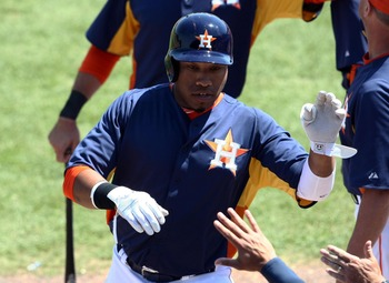 Mar 28, 2013; Kissimmee, FL, USA; Houston Astros first baseman Jonathan Singleton (14) celebrates after hitting his second home run of the game during the third inning against the Detroit Tigers at Osceola County Stadium. Mandatory Credit: Douglas Jones-U