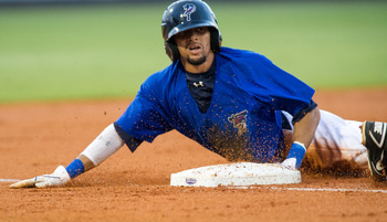PENSACOLA, FL - AUGUST 21:  Billy Hamilton #4 of the Pensacola Blue Wahoos slides safely into third base against the Montgomery Biscuits at Community Maritime Park Stadium on August 21, 2012 in Pensacola,  Florida. Billy Hamilton broke the minor league re