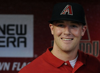 PHOENIX, AZ - JUNE 18:  Archie Bradley, the Arizona Diamondbacks' first pick in this year's draft, poses for a photo with Joe Garagiola Sr. during batting practice prior to a game against the Chicago White Sox at Chase Field on June 18, 2011 in Phoenix, A