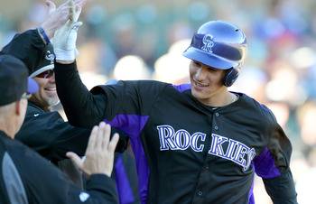 Feb 25, 2013; Salt River Pima-Maricopa, AZ, USA; Colorado Rockies third baseman Nolan Arenado (28) is congratulated after hitting a solo home run during the eighth inning against the Texas Rangers at Salt River Fields at Talking Stick. Mandatory Credit: J