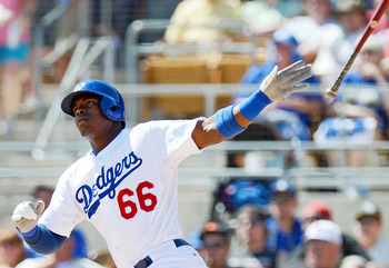 Mar 19, 2013; Glendale, AZ, USA; Los Angeles Dodgers center fielder Yasiel Puig (66) follows through on a two run home run during the first inning against the Oakland Athletics at Camelback Ranch. Mandatory Credit: Jake Roth-USA TODAY Sports