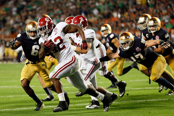 Eddie Lacy runs the ball in the BCS title game against Notre Dame