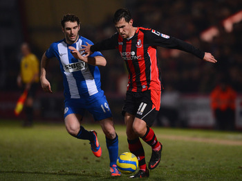 Mauro Boselli, left, scored the only goal of the game for Wigan at Bournemouth.