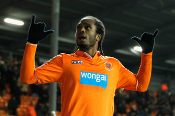 Nathan Delfouneso celebrates his opener for Blackpool but Fulham hit back to win the tie at Bloomfield Road.