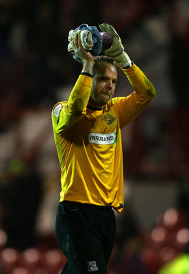 Former Brentford goalkeeper Paul Smith could not prevent his old club progressing to an FA Cup date with Chelsea despite saving a penalty for Southend.