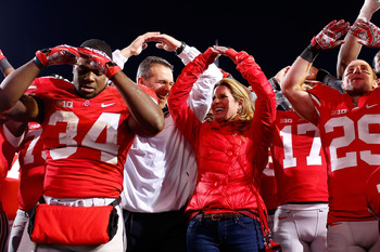 COLUMBUS, OH - NOVEMBER 03:  Head Coach Urban Meyer of the Ohio State Buckeyes and his wife, Shelly Meyer sing 'Carmen Ohio' after Ohio State defeated the Illinois Illini 52-22 on November 3, 2012 at Ohio Stadium in Columbus, Ohio. (Photo by Kirk Irwin/Ge