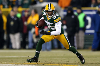 GREEN BAY, WI - JANUARY 05:  Wide receiver Greg Jennings #85 of the Green Bay Packers runs after a catch against the Minnesota Vikings during the NFC Wild Card Playoff game at Lambeau Field on January 5, 2013 in Green Bay, Wisconsin.  (Photo by Jonathan D