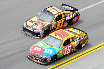 Kurt and Kyle Busch battling each other in a race last season.