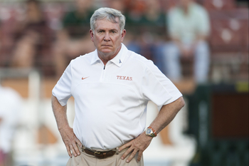 AUSTIN, TX - OCTOBER 20:  University of Texas head coach Mack Brown looks on as his team warms up before the Big 12 Conference game against the Baylor University Bears on October 20, 2012 at Darrell K Royal-Texas Memorial Stadium in Austin, Texas.  (Photo