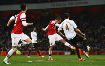 Jack Wilshere thrashes home the winning goal.