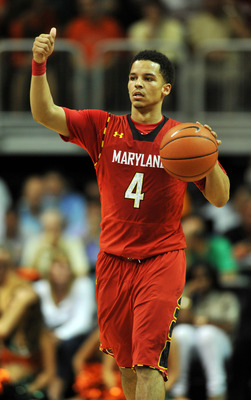 Jan 13, 2013; Coral Gables, FL, USA; Maryland Terrapins guard Seth Allen (4) dribbles during the first half against the Miami Hurricanes at the BankUnited Center. Mandatory Credit: Steve Mitchell-USA TODAY Sports