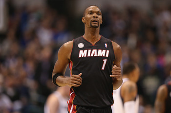 DALLAS, TX - DECEMBER 20:  Chris Bosh #1 of the Miami Heat at American Airlines Center on December 20, 2012 in Dallas, Texas.  NOTE TO USER: User expressly acknowledges and agrees that, by downloading and or using this photograph, User is consenting to th