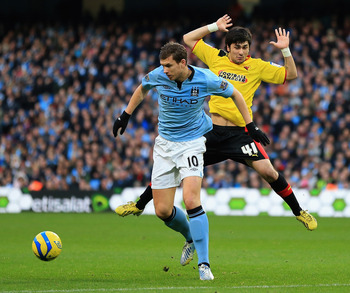 Edin Dzeko has eyes only for the ball against Watford.