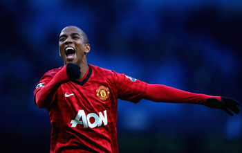 Ashley Young celebrates beating Manchester City.
