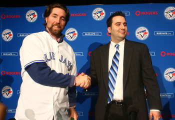 Alex Anthopoulos (right) wants one more bench player.