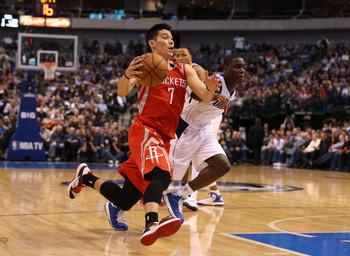 Jan 16, 2013; Dallas, TX, USA; Houston Rockets guard Jeremy Lin (7) drives against the Dallas Mavericks at the American Airlines Center. The Mavs beat the Rockets 105-100. Mandatory Credit: Matthew Emmons-USA TODAY Sports