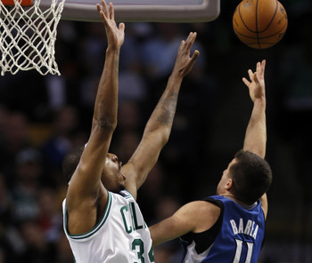 Dec 5, 2012; Boston, Massachusetts, USA; Minnesota Timberwolves point guard J.J. Barea (11) takes a shot while guarded by Boston Celtics small forward Paul Pierce (34) during the fourth quarter at TD Banknorth Garden. The Boston Celtics won 104-94.  Manda
