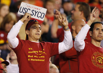 SALT LAKE CITY, UT - OCTOBER 4: Fans of the USC Trojans cheer during a game against the Utah Ute's during the first half of a college football game on October 4, 2012 at Rice-Eccles Stadium in Salt Lake City, Utah. (Photo by George Frey/Getty Images)