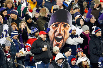 FOXBORO, MA - JANUARY 20:  A fan holds up a giant photo of the face of Ray Lewis #52 of the Baltimore Ravens during the 2013 AFC Championship game at Gillette Stadium on January 20, 2013 in Foxboro, Massachusetts.  (Photo by Jim Rogash/Getty Images)