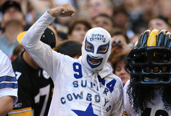 Dec 16, 2012; Arlington, TX, USA; Dallas Cowboys fan cheers on his team during the game against the Pittsburgh Steelers at Cowboys Stadium. The Cowboys beat the Steelers 27-24 in overtime. Mandatory Credit: Matthew Emmons-USA TODAY Sports