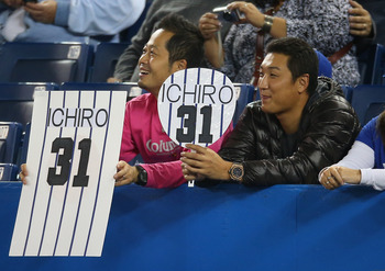 Sep 27, 2012; Toronto, ON, Canada; Fans of New York Yankees right fielder Ichiro Suzuki (not pictured) hold up signs against the Toronto Blue Jays at the Rogers Centre. The Blue Jays beat the Yankees 6-0. Mandatory Credit: Tom Szczerbowski-USA TODAY Sport