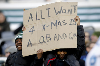 EAST RUTHERFORD, NJ - DECEMBER 23: New York Jets fans hold a sign during a game against the San Diego Chargers at MetLife Stadium on December 23, 2012 in East Rutherford, New Jersey. (Photo by Jeff Zelevansky /Getty Images)