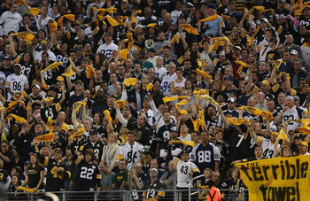 ARLINGTON, TX - DECEMBER 16:  Pittsburgh Steelers fans wave towels during a game against the Dallas Cowboys at Cowboys Stadium on December 16, 2012 in Arlington, Texas.  (Photo by Ronald Martinez/Getty Images)